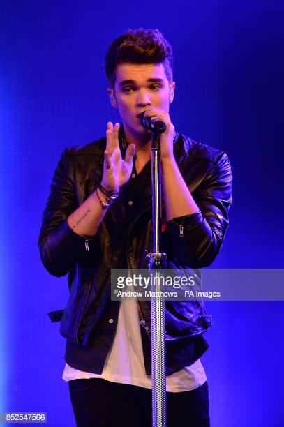 Josh Cuthbert of Union J performs at a concert at RAF Northolt to launch the Royal British Legions Poppy Appeal 2013