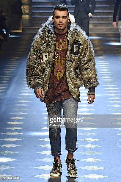Josh Cuthbert walks the runway at the Dolce Gabbana Autumn Winter 2017 fashion show during Milan Menswear Fashion Week on January 14 2017 in Milan...