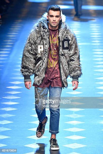Josh Cuthbert walks the runway at the Dolce Gabbana show during Milan Men's Fashion Week Fall/Winter 2017/18 on January 14 2017 in Milan Italy