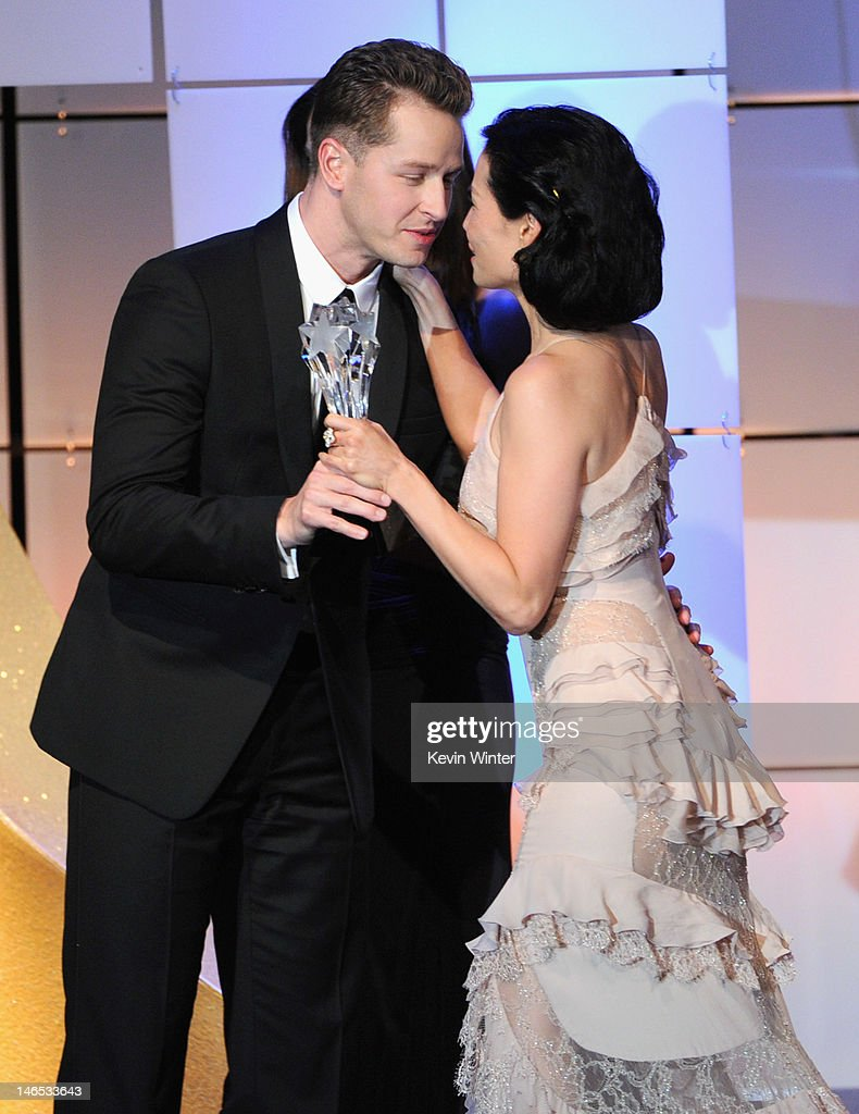 Josh Dallas (L) presents Lucy Liu with the Best Drama Guest Performer onstage during The Broadcast Television Journalists Association Second Annual Critics' Choice Awards at The Beverly Hilton Hotel on June 18, 2012 in Beverly Hills, California.