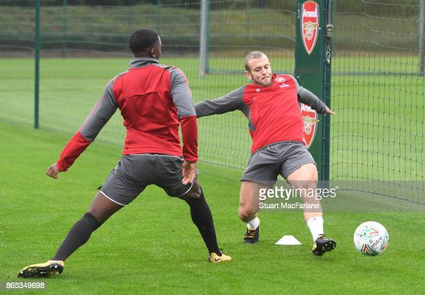Josh Dasilva and Jack Wilshere of Arsenal during a training session at London Colney on October 23 2017 in St Albans England