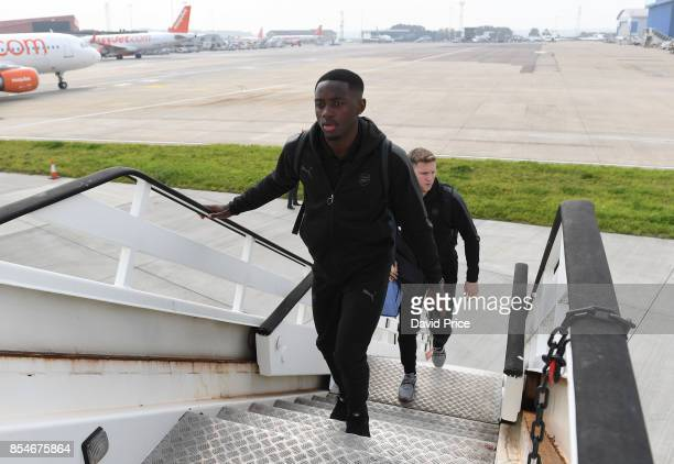 Josh Dasilva of Arsenal boards the plane at Luton Airport on September 27 2017 in Luton England