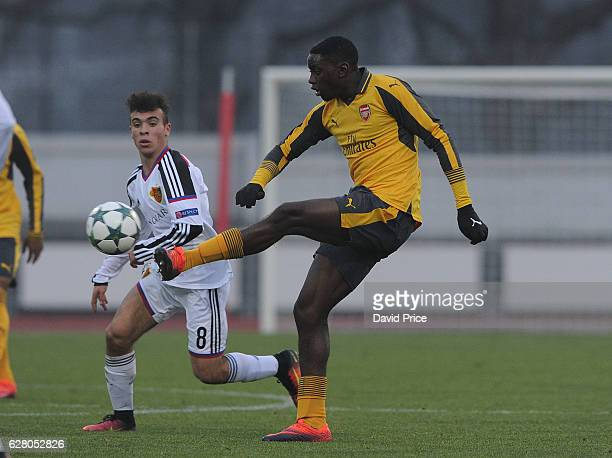 Josh Dasilva of Arsenal passes under pressure from Alessandro Stabile of Basel during the UEFA Champions League match between FC Basel and Arsenal at...