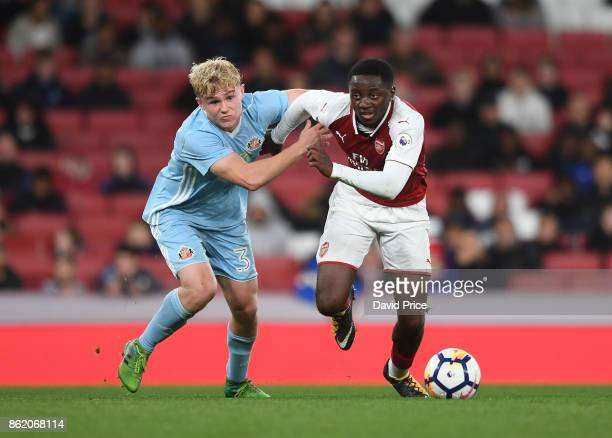 Josh Dasilva of Arsenal takes on Adam Bale of Sunderland during the Premier League 2 match between Arsenal and Sunderland at Emirates Stadium on...