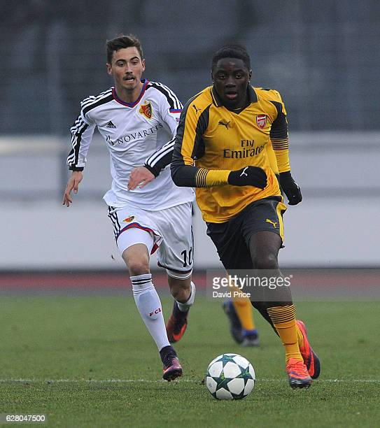 Josh Dasilva of Arsenal takes on Dominik Schmid of Basel during the UEFA Champions League match between FC Basel and Arsenal at Leichtathletik...