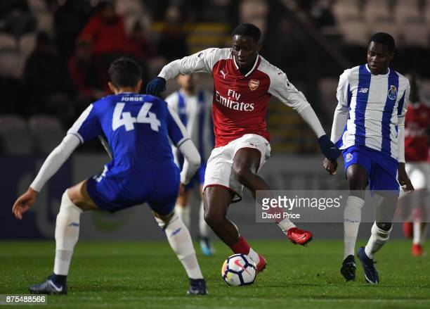 Josh Dasilva of Arsenal takes on Jorge Fernandes of Porto during the match between Arsenal U23 and Porto at Meadow Park on November 17 2017 in...
