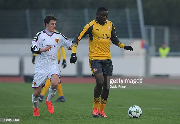 Josh Dasilva of Arsenal takes on Luca Tausch of Basel during the UEFA Champions League match between FC Basel and Arsenal at Leichtathletik Stadion...