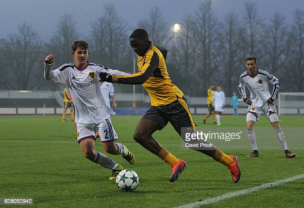 Josh Dasilva of Arsenal takes on Veriano Vogrig of Basel during the UEFA Champions League match between FC Basel and Arsenal at Leichtathletik...