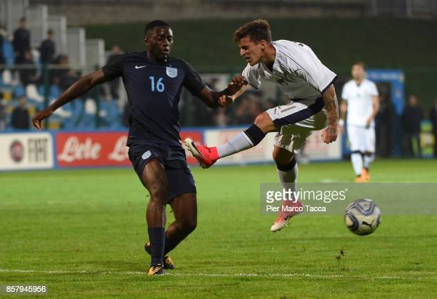 Josh Dasilva of England U20 competes for the ball with Simone Minelli of Italy U21 during the 8 Nations Tournament match between Italy U20 and...