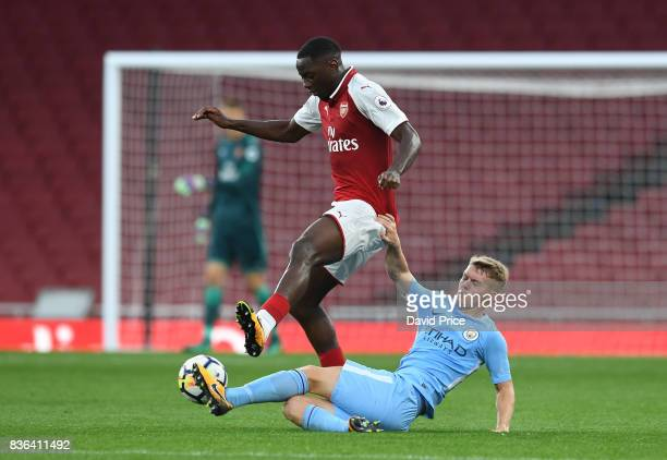 Josh Dasliva of Arsenal is challenged by Jacob Davenport of Man City during the match between Arsenal U23 and Manchester City U23 at Emirates Stadium...