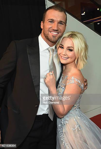 Josh Davis and RaeLynn attend the 50th annual CMA Awards at the Bridgestone Arena on November 2 2016 in Nashville Tennessee