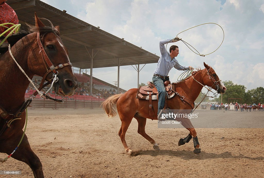 Josh DePooter (R) and Reed Pezanoski compete in the team roping competition at the Illinois High School Rodeo Association State Finals on June 16, 2012 in Altamont, Illinois. Winners in the competition will go on to compete in the high school national championships July 15-21 in Rock Springs, Wyoming.