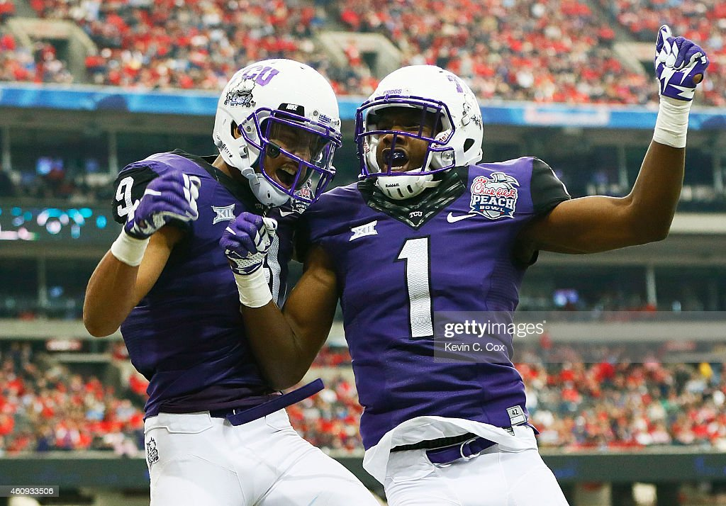 Josh Doctson #9 celebrates his touchdown with Emanuel Porter #1 of the TCU Horned Frogs in the second quarter against the Ole Miss Rebels during the Chik-fil-A Peach Bowl at Georgia Dome on December 31, 2014 in Atlanta, Georgia.