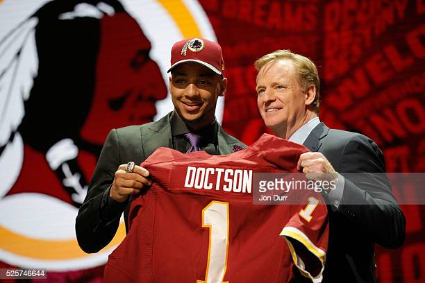 Josh Doctson of TCU holds up a jersey with NFL Commissioner Roger Goodell after being picked overall by the Washington Redskins during the first...