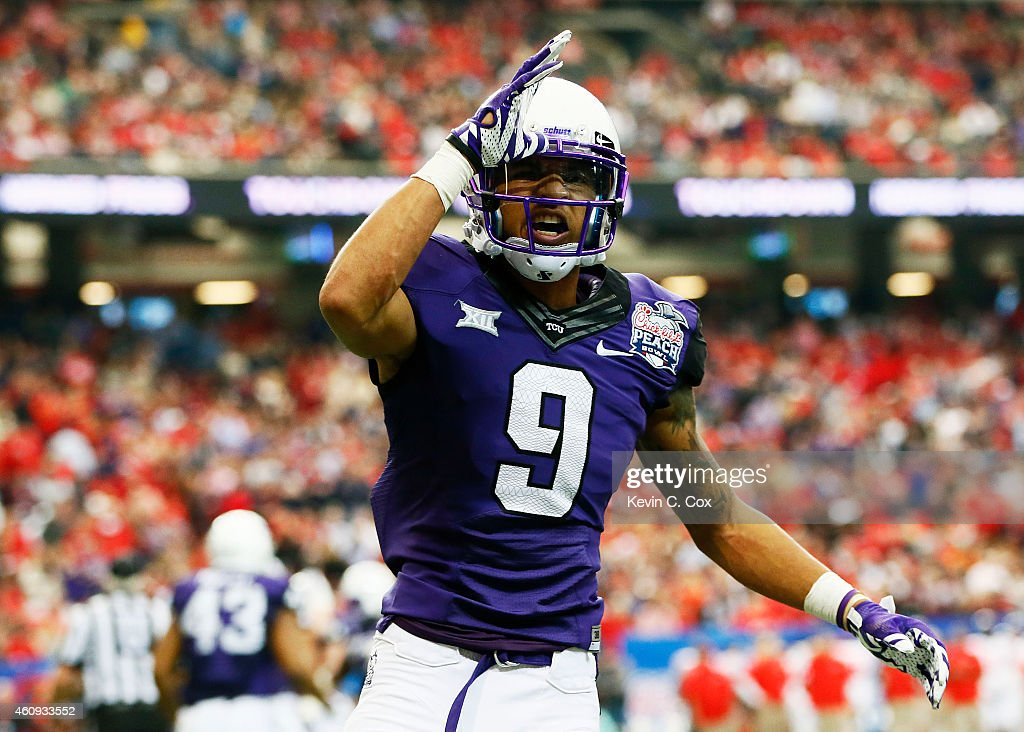 Josh Doctson #9 of the TCU Horned Frogs celebrates a touchdown in the second quarter against the Ole Miss Rebels during the Chik-fil-A Peach Bowl at Georgia Dome on December 31, 2014 in Atlanta, Georgia.