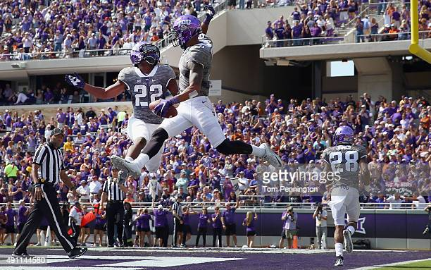 Josh Doctson of the TCU Horned Frogs celebrates with Aaron Green of the TCU Horned Frogs after scoring a touchdown against the Texas Longhorns in the...