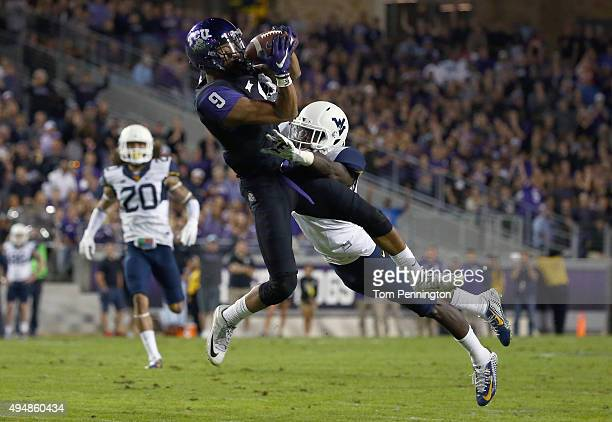 Josh Doctson of the TCU Horned Frogs pulls in a pass against KJ Dillon of the West Virginia Mountaineers in the first quarter at Amon G Carter...