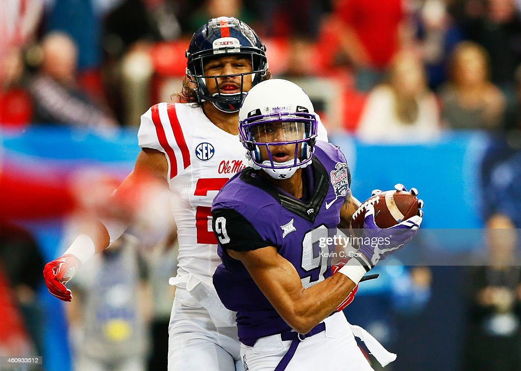 Josh Doctson #9 of the TCU Horned Frogs scores a touchdown against Cody Prewitt #25 of the Ole Miss Rebels in the second quarter during the Chik-fil-A Peach Bowl at Georgia Dome on December 31, 2014 in Atlanta, Georgia.