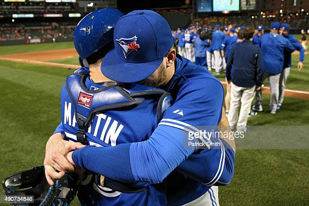 Josh Donaldson and Russell Martin of the Toronto Blue Jays celebrate after defeating the Baltimore Orioles and clinching the AL East Division during...