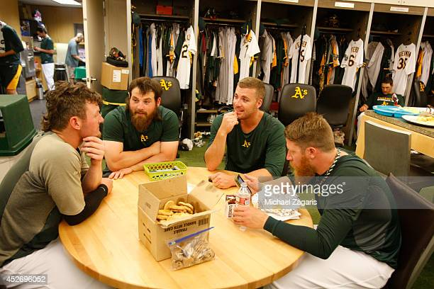 Josh Donaldson Derek Norris Eric O'Flaherty and Sean Doolittle of the Oakland Athletics relax in the clubhouse prior to the game against the Toronto...