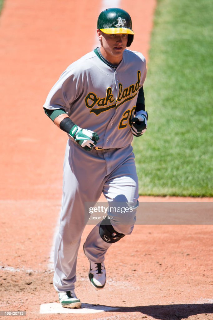 <a gi-track='captionPersonalityLinkClicked' href=/galleries/search?phrase=Josh+Donaldson&family=editorial&specificpeople=4959442 ng-click='$event.stopPropagation()'>Josh Donaldson</a> #20 of the Oakland Athletics after hitting a solo home run during the sixth inning against the Cleveland Indians at Progressive Field on May 9, 2013 in Cleveland, Ohio.