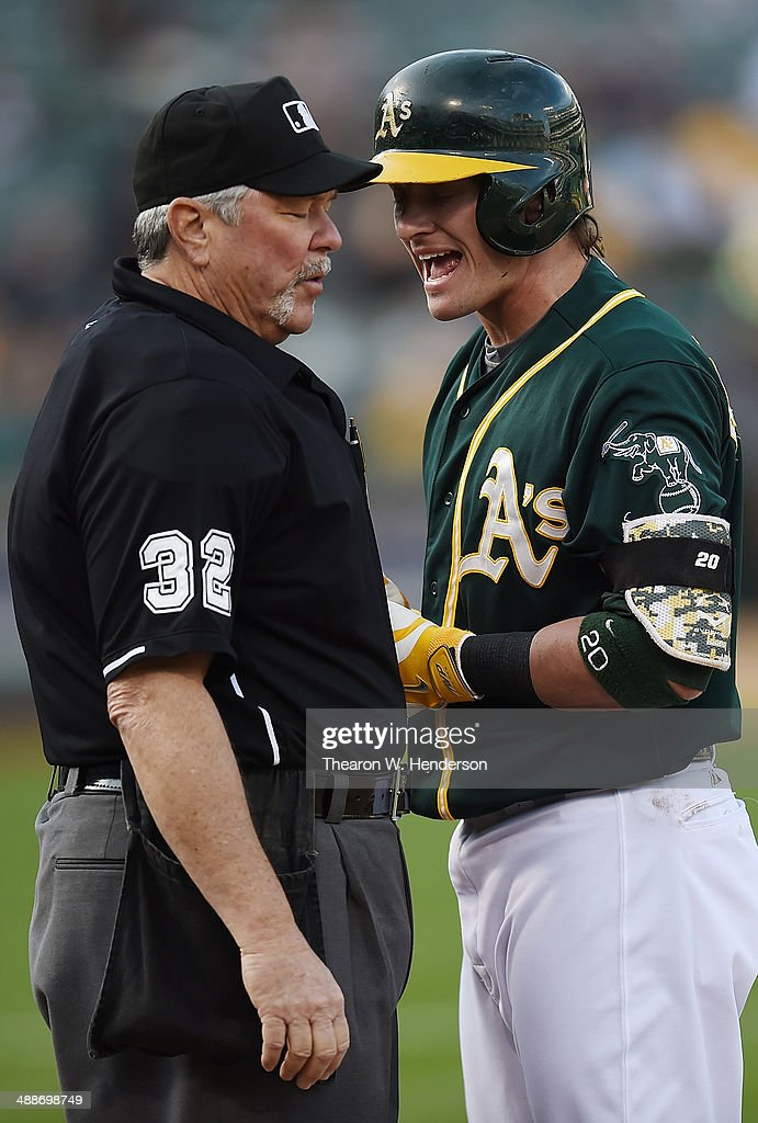 <a gi-track='captionPersonalityLinkClicked' href=/galleries/search?phrase=Josh+Donaldson&family=editorial&specificpeople=4959442 ng-click='$event.stopPropagation()'>Josh Donaldson</a> #20 of the Oakland Athletics argues with home plate umpire Dana DeMuth #32 after Donaldson was called out on strikes against the Seattle Mariners in the bottom of the six inning during game two of a doubleheader at O.co Coliseum on May 7, 2014 in Oakland, California. The Athletics won the game 2-0.