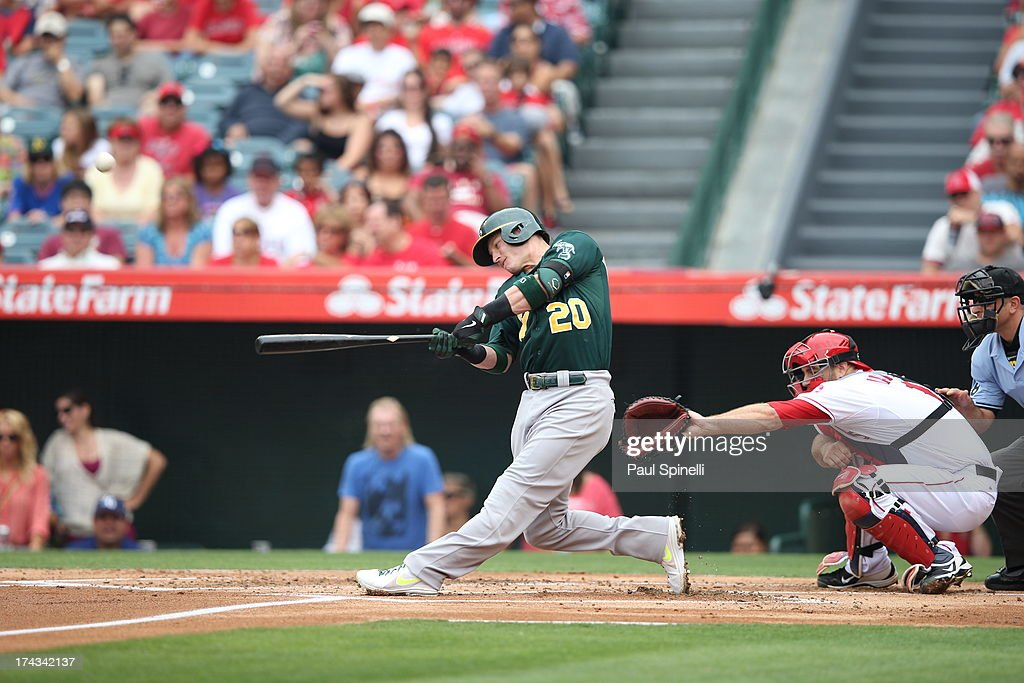 <a gi-track='captionPersonalityLinkClicked' href=/galleries/search?phrase=Josh+Donaldson&family=editorial&specificpeople=4959442 ng-click='$event.stopPropagation()'>Josh Donaldson</a> #20 of the Oakland Athletics bats against the Los Angeles Angels of Anaheim on Sunday, July 21, 2013 at Angel Stadium in Anaheim, California. The Athletics won the game in a 6-0 shutout.