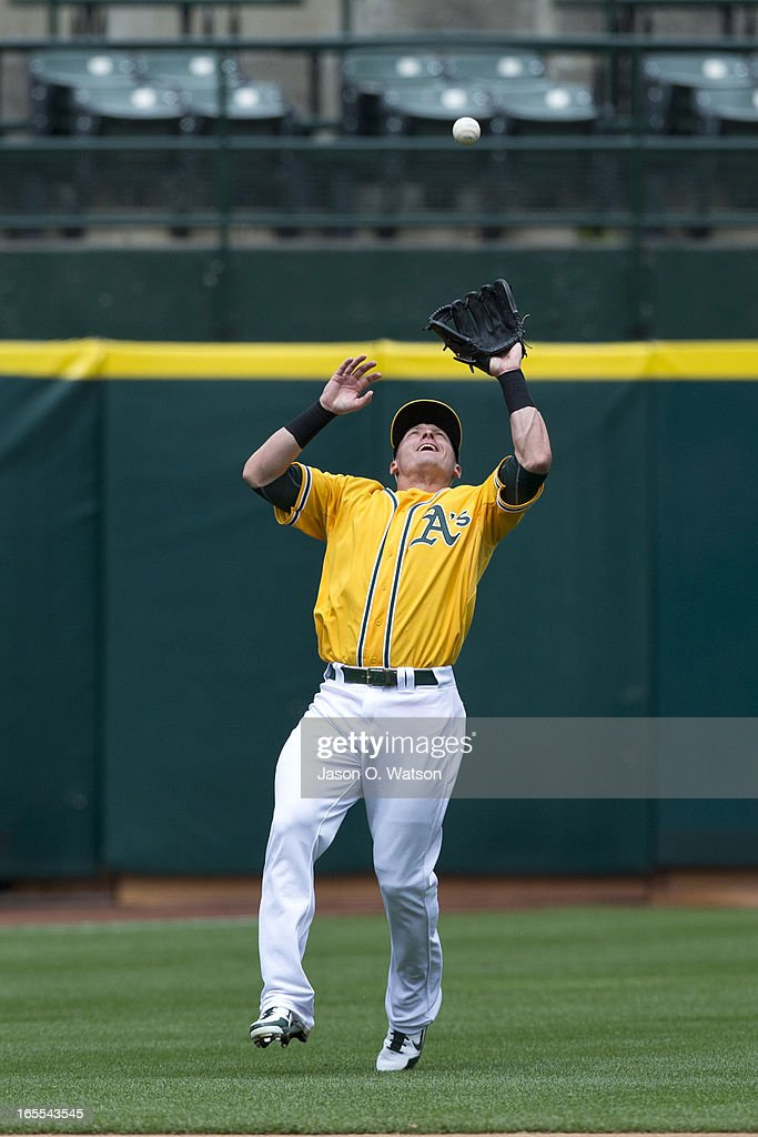 Josh Donaldson #20 of the Oakland Athletics catches a fly ball hit off the bat of Raul Ibanez #28 of the Seattle Mariners (not pictured) during the fifth inning at O.co Coliseum on April 4, 2013 in Oakland, California. The Oakland Athletics defeated the Seattle Mariners 8-2.