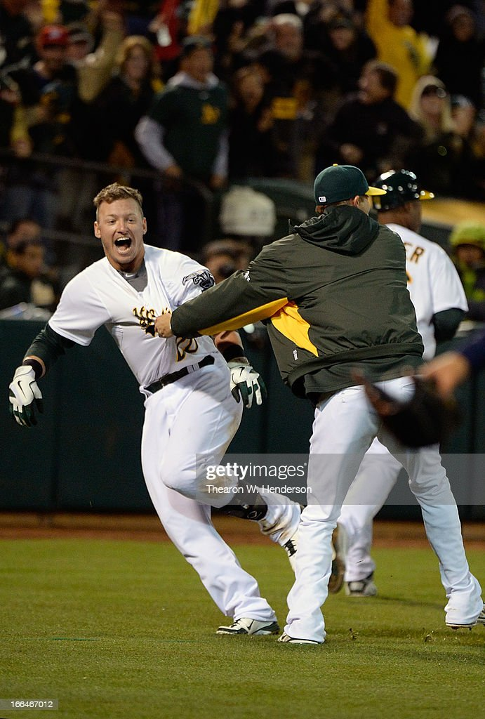 Josh Donaldson #20 of the Oakland Athletics celebrates after hitting a walk-off solo home run against the Detroit Tigers in the bottom of the 12th inning at O.co Coliseum on April 12, 2013 in Oakland, California. The Athletics won the game 4-3.