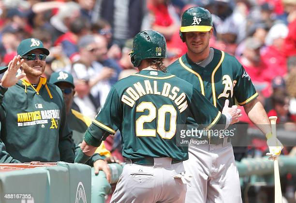 Josh Donaldson of the Oakland Athletics celebrates with teammates in the first inning after scoring a run against the Oakland Athletics at Fenway...