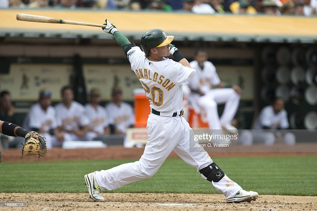 <a gi-track='captionPersonalityLinkClicked' href=/galleries/search?phrase=Josh+Donaldson&family=editorial&specificpeople=4959442 ng-click='$event.stopPropagation()'>Josh Donaldson</a> #20 of the Oakland Athletics hits a two run home run off of Madison Bumgarner (not pictured) of the San Francisco Giants during the fourth inning of the interleague game at O.co Coliseum on May 27, 2013 in Oakland, California.