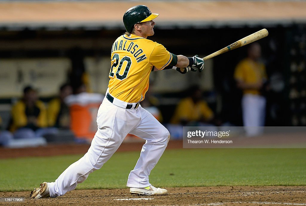 <a gi-track='captionPersonalityLinkClicked' href=/galleries/search?phrase=Josh+Donaldson&family=editorial&specificpeople=4959442 ng-click='$event.stopPropagation()'>Josh Donaldson</a> #20 of the Oakland Athletics hits an RBI single scoring Josh Reddick #16 in the sixth inning against the Cleveland Indians at O.co Coliseum on August 17, 2013 in Oakland, California.
