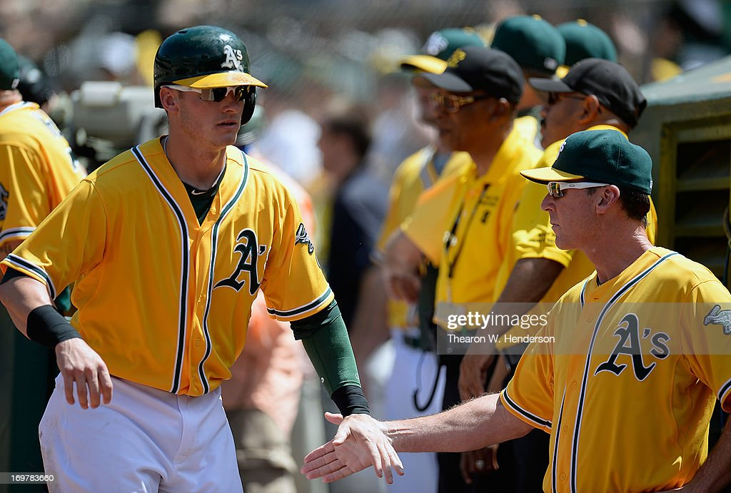 <a gi-track='captionPersonalityLinkClicked' href=/galleries/search?phrase=Josh+Donaldson&family=editorial&specificpeople=4959442 ng-click='$event.stopPropagation()'>Josh Donaldson</a> #20 of the Oakland Athletics is congratulated by manager <a gi-track='captionPersonalityLinkClicked' href=/galleries/search?phrase=Bob+Melvin&family=editorial&specificpeople=239192 ng-click='$event.stopPropagation()'>Bob Melvin</a> #6 after Donaldson scored during the fifth inning against the Chicago White Sox at O.co Coliseum on June 1, 2013 in Oakland, California.
