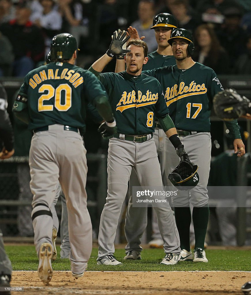 <a gi-track='captionPersonalityLinkClicked' href=/galleries/search?phrase=Josh+Donaldson&family=editorial&specificpeople=4959442 ng-click='$event.stopPropagation()'>Josh Donaldson</a> #20 of the Oakland Athletics is greeted by <a gi-track='captionPersonalityLinkClicked' href=/galleries/search?phrase=Jed+Lowrie&family=editorial&specificpeople=4949369 ng-click='$event.stopPropagation()'>Jed Lowrie</a> #8, <a gi-track='captionPersonalityLinkClicked' href=/galleries/search?phrase=Adam+Rosales&family=editorial&specificpeople=4921731 ng-click='$event.stopPropagation()'>Adam Rosales</a> #17 and <a gi-track='captionPersonalityLinkClicked' href=/galleries/search?phrase=Nate+Freiman&family=editorial&specificpeople=9750566 ng-click='$event.stopPropagation()'>Nate Freiman</a> #7 after hitting a grand slam home run in the 6th inning against the Chicago White Sox at U.S. Cellular Field on June 7, 2013 in Chicago, Illinois.