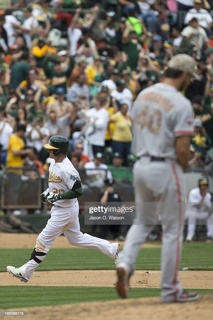 <a gi-track='captionPersonalityLinkClicked' href=/galleries/search?phrase=Josh+Donaldson&family=editorial&specificpeople=4959442 ng-click='$event.stopPropagation()'>Josh Donaldson</a> #20 of the Oakland Athletics rounds the bases after hitting a two run home run off of <a gi-track='captionPersonalityLinkClicked' href=/galleries/search?phrase=Madison+Bumgarner&family=editorial&specificpeople=5974095 ng-click='$event.stopPropagation()'>Madison Bumgarner</a> #40 of the San Francisco Giants during the fourth inning of the interleague game at O.co Coliseum on May 27, 2013 in Oakland, California.