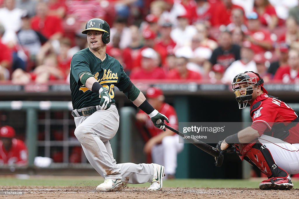 <a gi-track='captionPersonalityLinkClicked' href=/galleries/search?phrase=Josh+Donaldson&family=editorial&specificpeople=4959442 ng-click='$event.stopPropagation()'>Josh Donaldson</a> #20 of the Oakland Athletics singles to drive in a run in the sixth inning of the game against the Cincinnati Reds at Great American Ball Park on August 7, 2013 in Cincinnati, Ohio. The Reds won 6-5.