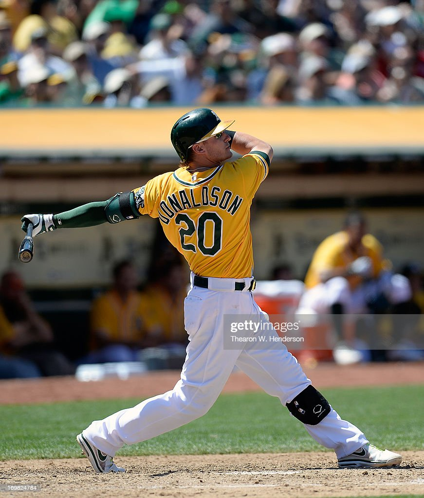 <a gi-track='captionPersonalityLinkClicked' href=/galleries/search?phrase=Josh+Donaldson&family=editorial&specificpeople=4959442 ng-click='$event.stopPropagation()'>Josh Donaldson</a> #20 of the Oakland Athletics swings and watches the flight of his ball as he hits a sacrifice fly, scoring Coco Crisp #4 during the six inning against the Chicago White Sox at O.co Coliseum on June 2, 2013 in Oakland, California.
