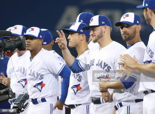 Josh Donaldson of the Toronto Blue Jays acknowledges the fans as he is introduced before the start of their home opener against the Milwaukee Brewers...