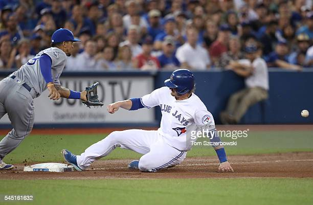 Josh Donaldson of the Toronto Blue Jays advances safely to third base from first base on a single by Michael Saunders in the seventh inning during...