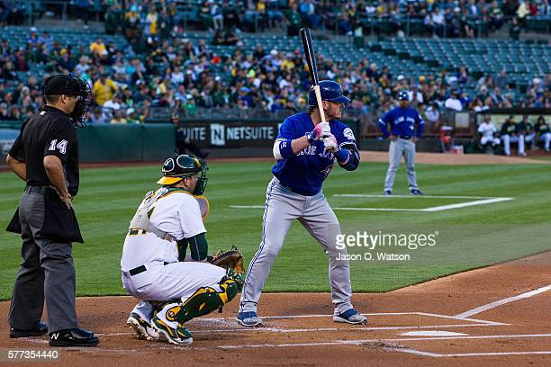 Josh Donaldson of the Toronto Blue Jays at bat in front of Stephen Vogt of the Oakland Athletics and umpire Mark Wegner during the first inning at...