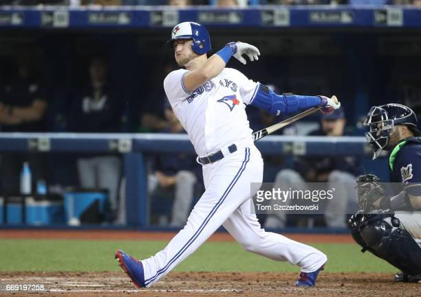 Josh Donaldson of the Toronto Blue Jays bats during his pinchhit at bat in the ninth inning during MLB game action against the Milwaukee Brewers at...