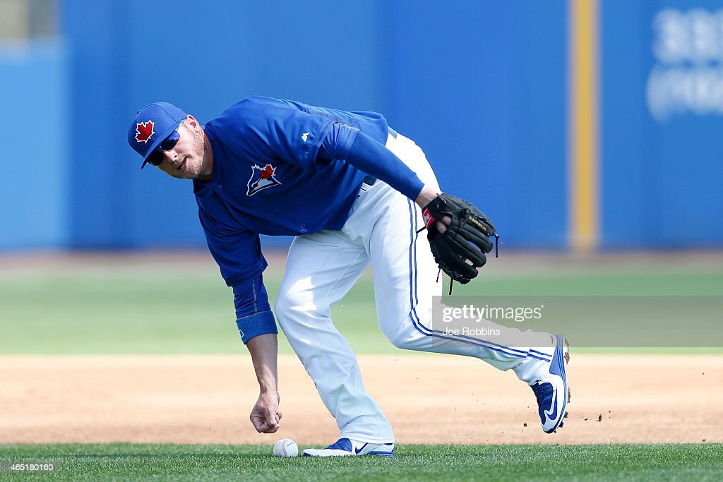Josh Donaldson #20 of the Toronto Blue Jays boots a ground ball at third base during the game against the Pittsburgh Pirates at Florida Auto Exchange Stadium on March 3, 2015 in Dunedin, Florida. The Pirates defeated the Blue Jays 8-7.