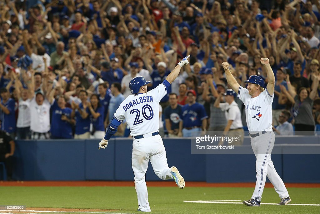 Josh Donaldson #20 of the Toronto Blue Jays celebrates after his game-winning RBI single in the eleventh inning during MLB game action against the Kansas City Royals on July 31, 2015 at Rogers Centre in Toronto, Ontario, Canada.