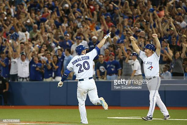 Josh Donaldson of the Toronto Blue Jays celebrates after his gamewinning RBI single in the eleventh inning during MLB game action against the Kansas...