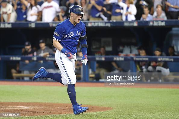 Josh Donaldson of the Toronto Blue Jays celebrates after hitting a solo home run in the third inning against Corey Kluber of the Cleveland Indians...