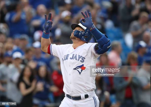 Josh Donaldson of the Toronto Blue Jays celebrates after hitting a solo home run in the first inning during MLB game action against the New York...