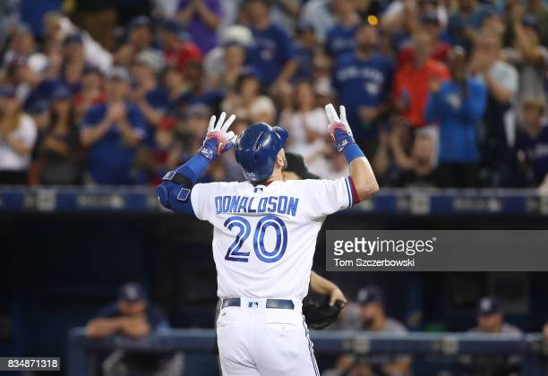 Josh Donaldson of the Toronto Blue Jays celebrates after hitting a solo home run in the first inning during MLB game action against the Tampa Bay...