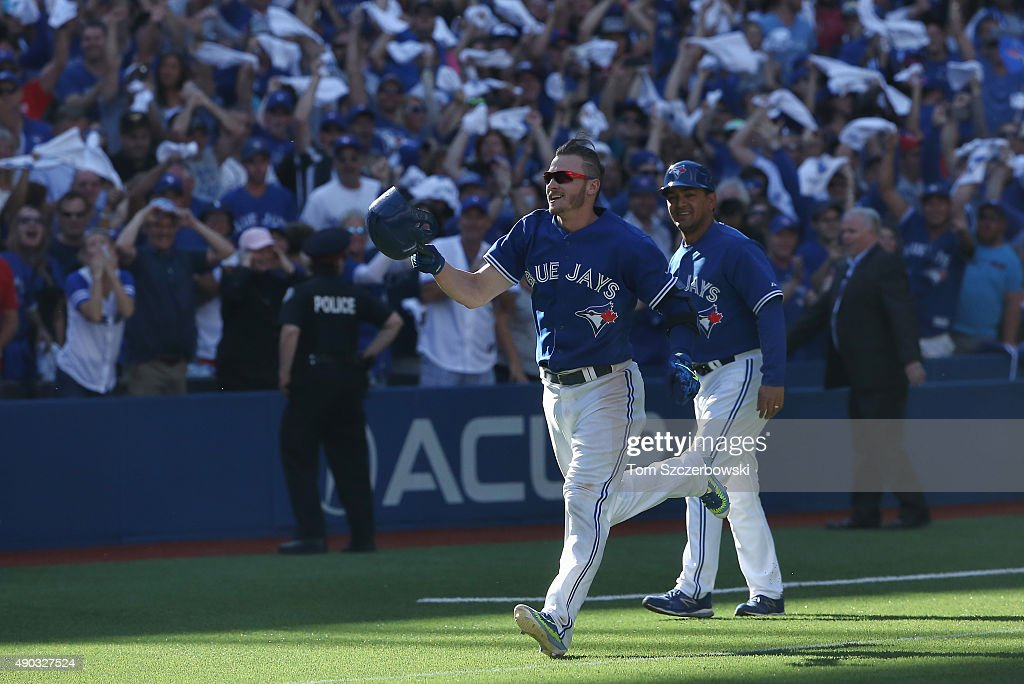Josh Donaldson #20 of the Toronto Blue Jays celebrates as he rounds the bases after hitting a game-winning solo home run in the ninth inning during MLB game action against the Tampa Bay Rays on September 27, 2015 at Rogers Centre in Toronto, Ontario, Canada.