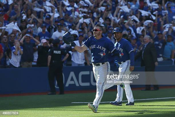 Josh Donaldson of the Toronto Blue Jays celebrates as he rounds the bases after hitting a gamewinning solo home run in the ninth inning during MLB...