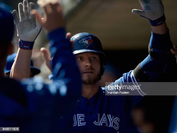 Josh Donaldson of the Toronto Blue Jays celebrates hitting a solo home run against the Minnesota Twins during the second inning of the game on...